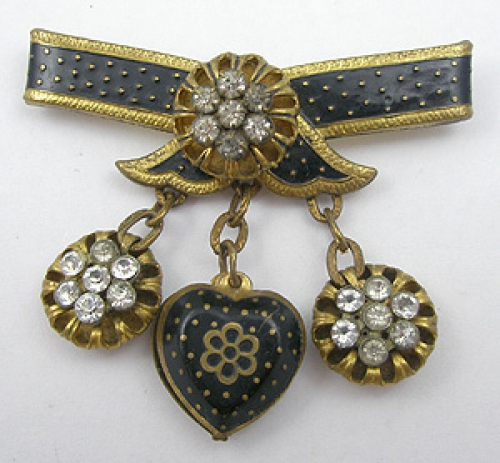 Newly Added Schiaparelli Black Enameled Bow Brooch