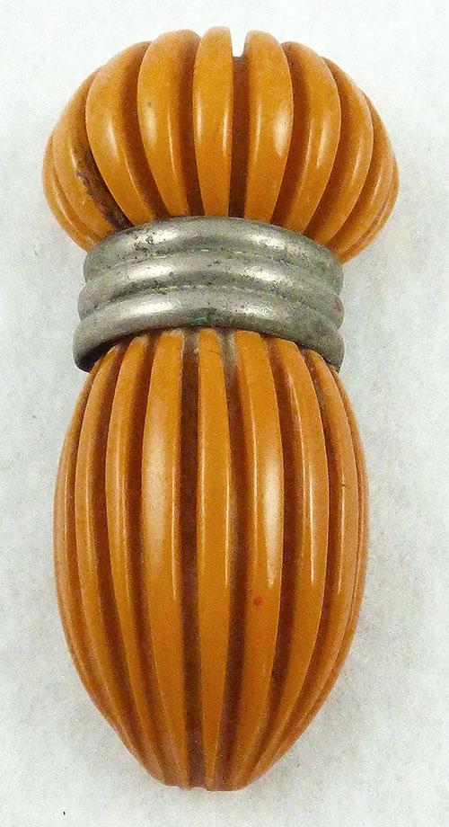 Bakelite, Celluloid, Galalith - Carved Butterscotch Bakelite Dress Clip