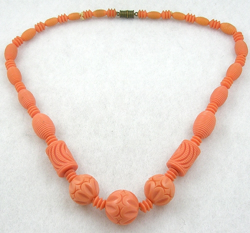 Bakelite, Celluloid, Galalith - Carved Orange Galalith Bead Necklace