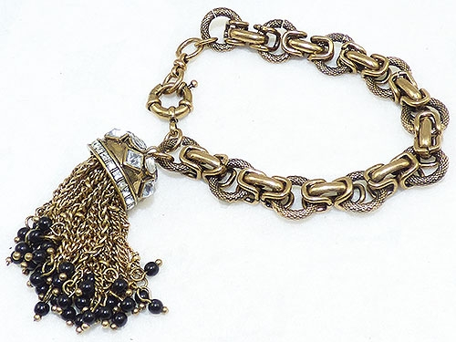 Trend 2020-2021: Tassels and Chunky Chains - Gold Tone Tassel Charm Brcelet